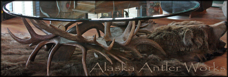 Antler carvings and scrimshaw on antler