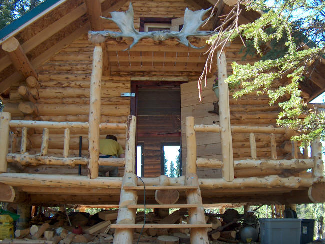 Building a log cabin in alaska the porch and cabinets for Building a cabin in alaska