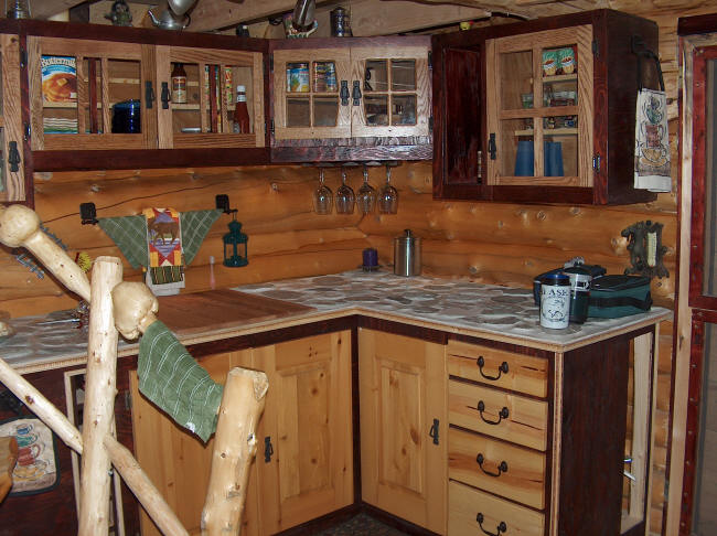Building a log cabin in alaska the porch and cabinets for Ak kitchen cabinets